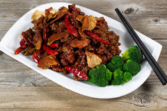 Chinese succulent chicken and tofu with broccoli dish ready to e Royalty Free Stock Photo