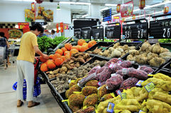 Chinese supermarket. Shopping at the chinese supermarket,because of inflation, the supermarket's soaring commodity prices, very few people to buy goods.this Royalty Free Stock Photography