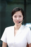 Chinese sustomer service agent. One chinese sustomer service agent Royalty Free Stock Images