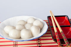 Chinese sweet dumplings. Chinese traditional sweet dumplings with chopsticks Royalty Free Stock Photos