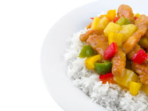 Chinese sweet and sour chicken. Sweet and sour chicken on a white plate with copy space on left side Stock Photo