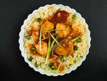 Chinese Sweet and Sour Chicken. With Egg Fried Rice Meal Stock Photo