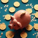 The New Year of Golden Pig.Traditional chinese symbol piggy ba. Chinese symbol of the new year 2019 golden pig on the background of chocolate coins and stars stock photography