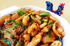 Chinese Szechuan hot spicy seafood dish. A photograph showing a typical Sichuan style cuisine dish of hot and spicy sea foods, stir fried with green spring Stock Photography