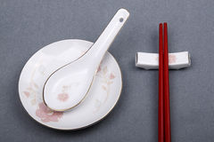 Chinese tableware. On grey background Royalty Free Stock Photos