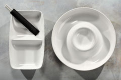 Chinese tableware. Details of Chinese tableware or dishes and chopsticks Royalty Free Stock Images