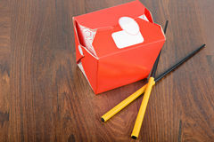 Chinese take away red food box with chopstocks Stock Image
