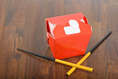 Chinese take away red food box and chopstocks Royalty Free Stock Image