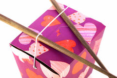 Chinese Take-Out. Heart-decorated Chinese take-out food container with wood chopsticks on top stock photo