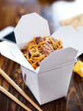 Chinese take out with smart phone on table and menu. Shot with selective focus Royalty Free Stock Photos