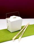 Chinese Takeaway. Chop sticks and a takeaway box on a kitchen bench Stock Image