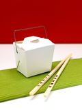 Chinese Takeaway. Chop sticks and a takeaway box on a kitchen bench Stock Photo