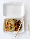 Chinese takeaway food. An image of chinese takeout food - white rice with assorted meats such as Sichuan style diced chicken and onions, and stir fried stock images