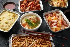 Free Chinese Takeaway Food. Pork Wonton Dumpling Soup, Crispy Shredded Beef, Sweet And Sour Pineapple Chicken, Egg Noodles Stock Photography - 148694882