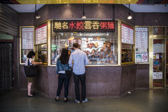Chinese takeaway food. A young couple choose from the variety of takeaway food from a BBQ store in Chinatown, Sydney Royalty Free Stock Images