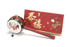 Chinese Tambourine and Red Packet Stock Photography