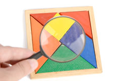 Chinese tangram and magnifier Stock Image