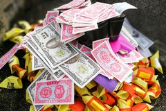Chinese taoism tradition burn paper money and gold to ancestors Royalty Free Stock Image