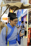 Chinese taoist priest using smart phone tencent wechat. Traditional religious people have begun to use modern communication tools Stock Photography