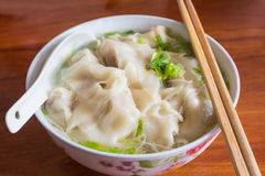 Chinese tasty wonton and noodle soup. Royalty Free Stock Images