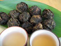 Chinese Tea 1. Balls of high quality dried Chinese tea leaves. Cups of freshly brewed Chinese tea ready for drinking royalty free stock photos