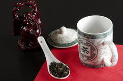 Chinese tea. Tea is an aromatic beverage prepared by adding cured leaves of the Camellia sinensis plant to hot water Royalty Free Stock Image