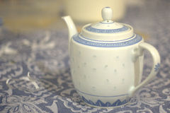 Chinese Tea. Chines Teapot on matching blue tablecloth royalty free stock photography