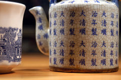 Chinese Tea. A teapot and cup with Chinese writing and designs stock photos