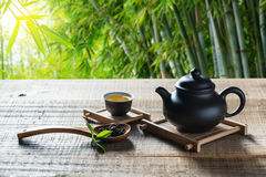 Chinese tea ceremony. Tea cup,teapot and tealeaves on wood plank outside the door Stock Photography