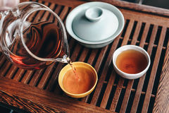Chinese tea ceremony, Filling the tea bowl with tea Stock Photos