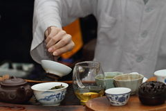 Chinese tea ceremony. Leisure lifestyle,Wear Chinese clothes hand lift the Cup scene Royalty Free Stock Image