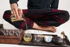 Chinese tea ceremony is perfomed by master Royalty Free Stock Images