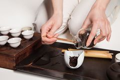 Chinese tea ceremony is perfomed by master Royalty Free Stock Photo