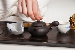 Chinese tea ceremony is perfomed by master Royalty Free Stock Photography