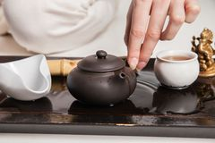 Chinese tea ceremony is perfomed by master Royalty Free Stock Photos