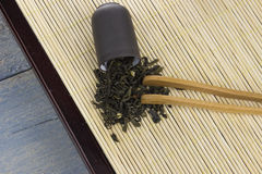 Chinese tea ceremony. Tea scattered on a bamboo napkin Stock Image