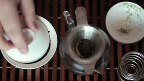 Chinese tea ceremony on tea table, close up, toned video stock footage