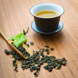 Chinese tea ceremony. Tealeaves and teacup on the bamboo mat Royalty Free Stock Photography
