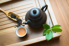 Chinese tea ceremony. Tealeaves,teacup and teapot on the bamboo mat Stock Photo