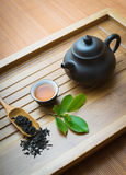 Chinese tea ceremony. Tealeaves,teacup and teapot on the bamboo mat Royalty Free Stock Images
