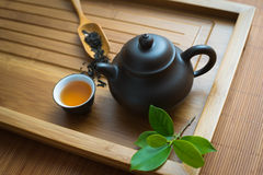 Chinese tea ceremony. Tealeaves,teacup and teapot on the bamboo mat Royalty Free Stock Image