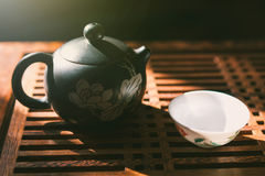 Chinese tea ceremony. Teapot and a cup of green puer tea on wooden table. Asian traditional culture. Stock Photography