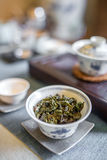 Chinese tea ceremony. Traditional cup with green tea leaves Royalty Free Stock Images