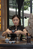 Chinese tea ceremony. A young chinese girl is showing japanese tea ceremony stock photo