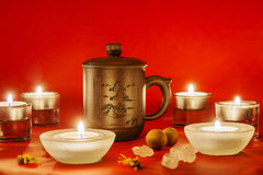 Chinese tea cup with candles Royalty Free Stock Images