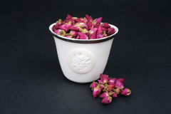 Chinese Tea Cup Filled With Dried Roses Royalty Free Stock Photo