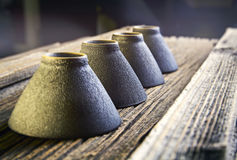 Chinese tea cup. On vintage wood table Stock Photos
