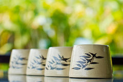Chinese tea cups. In a row Royalty Free Stock Photo