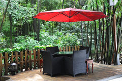 Chinese tea house with red umbrella. Chinese tea house in the bamboo forest stock photo