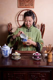 Chinese tea lady, traditionally dressed. Attractive woman inside a traditional tea house stock image